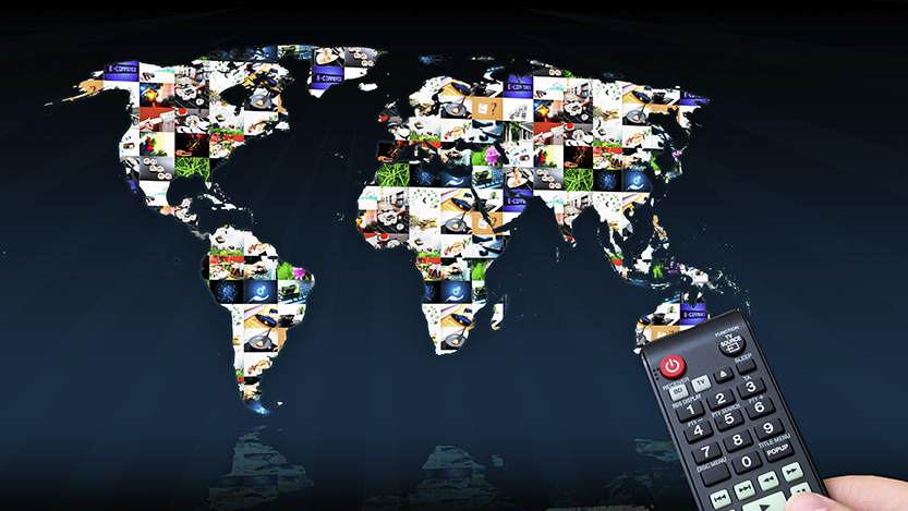 Remote control with virtual multimedia screen in background. World map composition